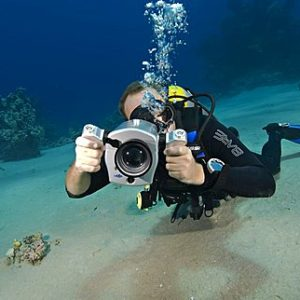 Underwater Videographer in the shallows of Marsa Baraka,Ras Mohamed National Park; Red Sea; Sharm El Sheikh; South Sinai,Egypt.